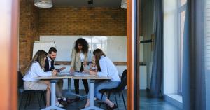 Marketing team around a table